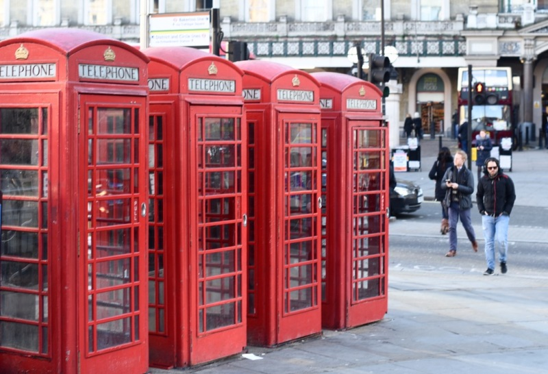 K6 telephone boxes near Charing Cross Station by Sue Lowry